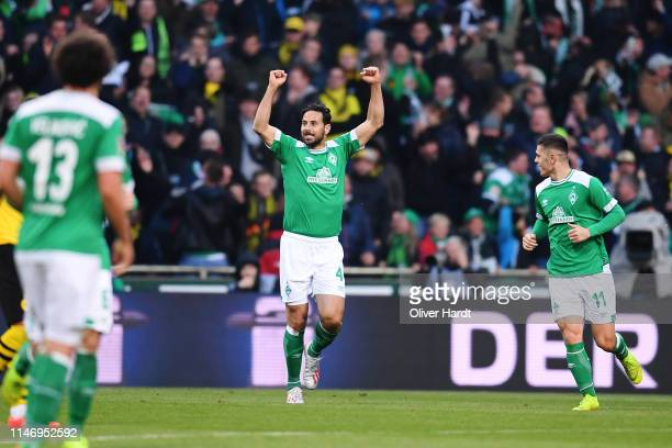 Claudio Pizarro of SV Werder Bremen celebrates after scoring his team's first goal during the Bundesliga match between SV Werder Bremen and Borussia...