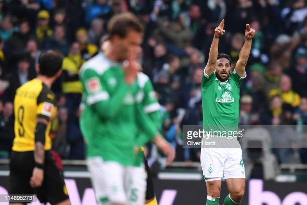 Claudio Pizarro of SV Werder Bremen celebrates after scoring his team's first goal during the Bundesliga match between SV Werder Bremen and Borussia...