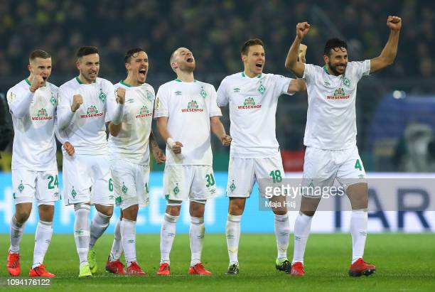 Claudio Pizarro of Werder Bremen and teammates celebrate as his team win the penalty shoot out during the DFB Cup match between Borussia Dortmund and...
