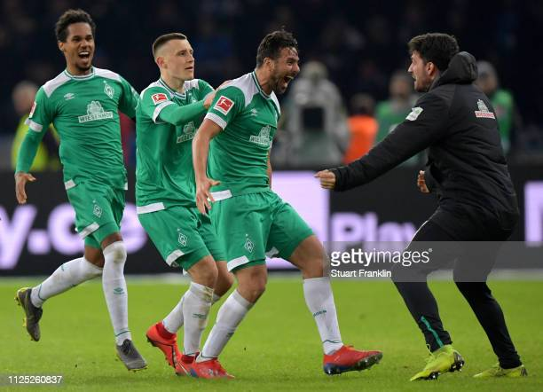 Claudio Pizarro of Werder Bremen celebrates after scoring his team's first goal with his team mates during the Bundesliga match between Hertha BSC...