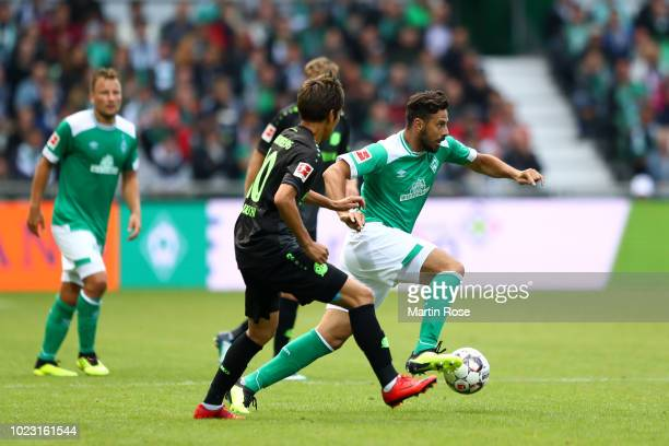 Claudio Pizarro of Werder Bremen controls the ball as Daniel Baier of Augsburg during the Bundesliga match between SV Werder Bremen and Hannover 96...