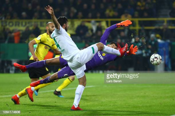 Claudio Pizarro of Werder Bremen scores his team's second goal during the DFB Cup match between Borussia Dortmund and Werder Bremen at Signal Iduna...