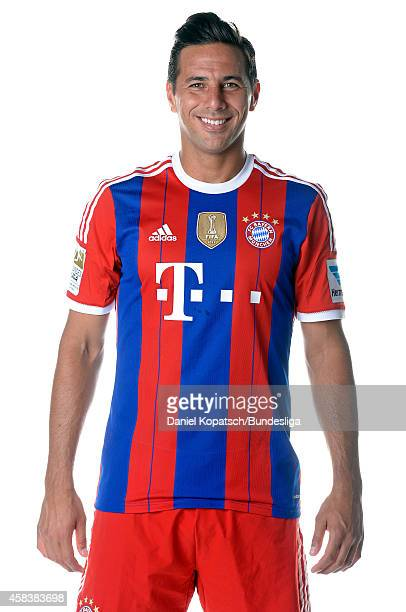 Claudio Pizarro poses during the FC Bayern Muenchen Team Presentation for DFL on August 9 2014 in Munich Germany