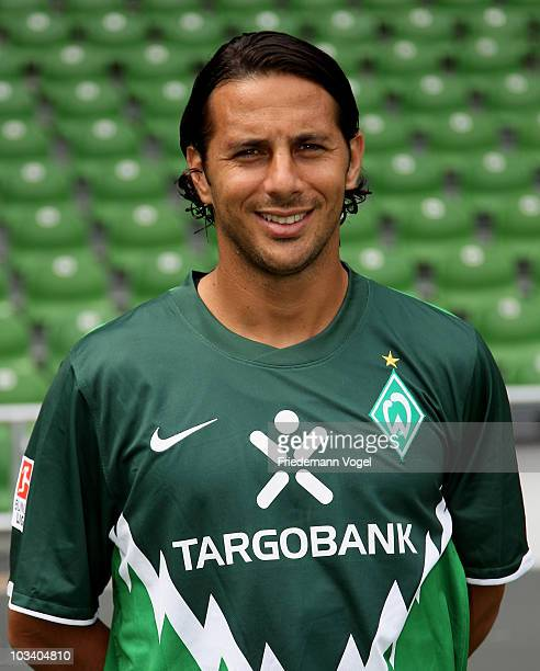 Claudio Pizarro poses during the team presentation at the Weser stadium on August 16 2010 in Bremen Germany