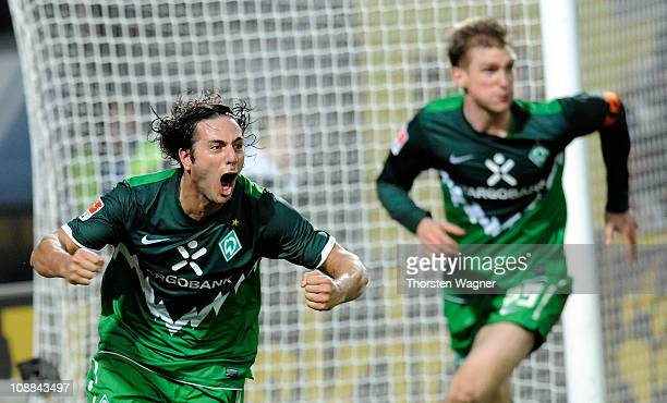 Claudio Pizzaro of Bremen celebrates after scoring his team's first goal during the Bundesliga match between FSV Mainz 05 and SV Werder Bremen at...