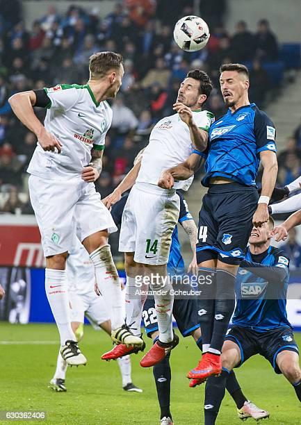 Claudio Pizzaro of Bremen challenges Sandro Wagner of Hoffenheim during the Bundesliga match between TSG 1899 Hoffenheim and Werder Bremen at Wirsol...