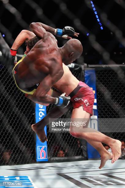 Claudio Puelles of Peru punches Marcos Mariano of Brazil in their lightweight bout during UFC Fight Night event at Arena Ciudad de Mexico on...
