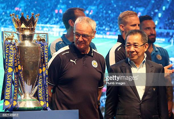 Claudio Ranieri and Vichai Srivaddhanaprabha looks on at the Premier League trophy during a Leicester City press conference ahead of their postseason...