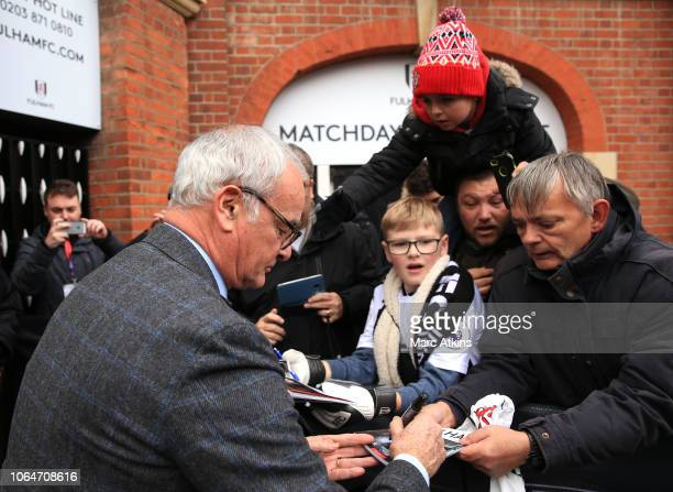Claudio Ranieri Manager of Fulham signs autographs outside the stadium prior to the Premier League match between Fulham FC and Southampton FC at...