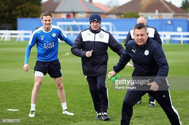 Claudio Ranieri manager of Leicester City and Andy King take part during a Leicester City training session at Belvoir Drive Training Ground on May 3...