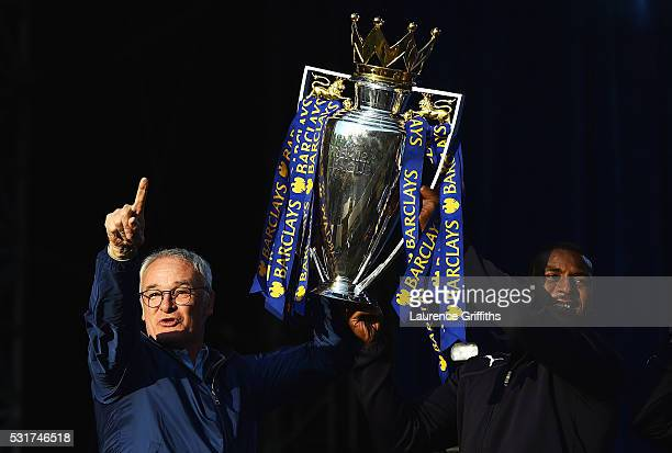 Claudio Ranieri Manager of Leicester City and captain Wes Morgan of Leicester City show the trophy to the fans during the Leicester City Barclays...