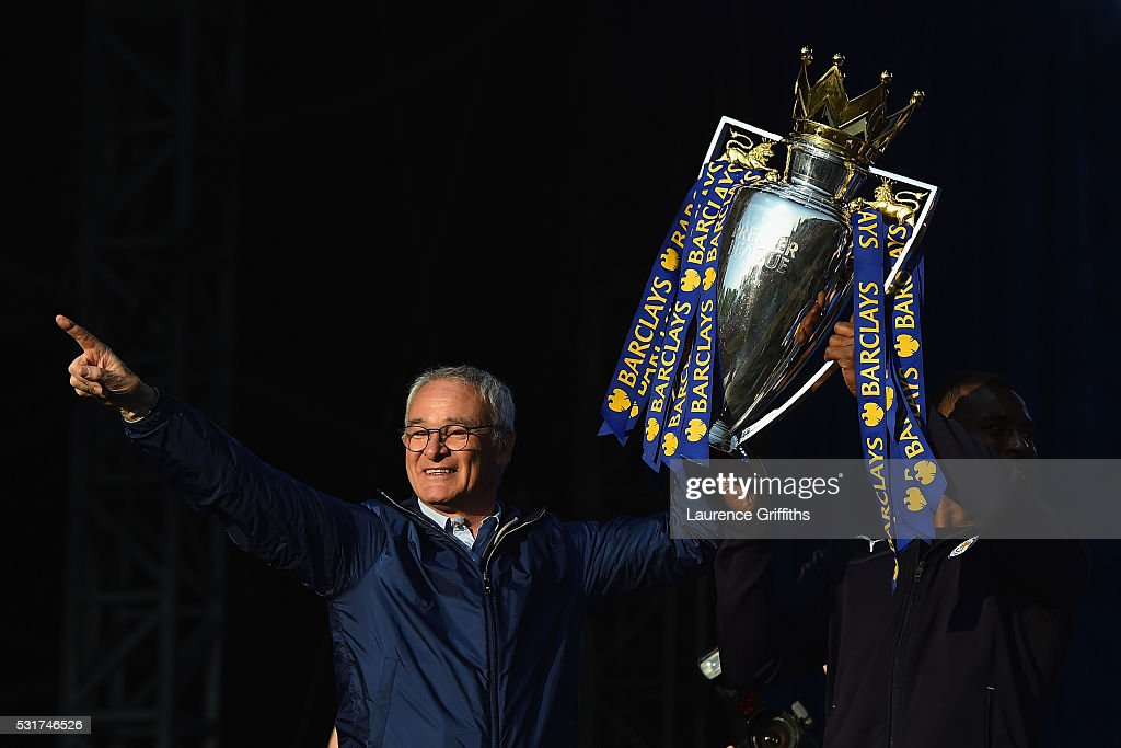 Claudio Ranieri Manager of Leicester City and captain Wes Morgan of Leicester City show the trophy to the fans during the Leicester City Barclays Premier League winners bus parade on May 16, 2016 in Leicester, England.