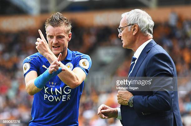 Claudio Ranieri Manager of Leicester City and Jamie Vardy of Leicester City talk tatics on the sideline during the Premier League match between Hull...
