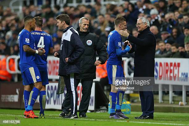 Claudio Ranieri Manager of Leicester City congratulates Jamie Vardy after replacing him during the Barclays Premier League match between Newcastle...