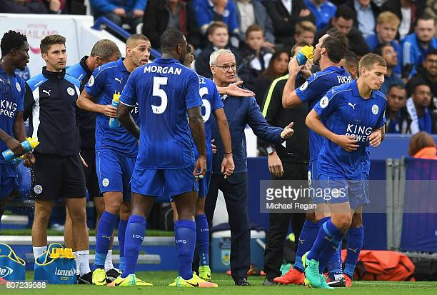 Claudio Ranieri Manager of Leicester City gives his team instructions as they take on water during the Premier League match between Leicester City...