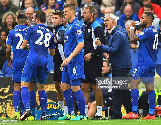 Claudio Ranieri Manager of Leicester City gives his team instructions while they have a water break during the Premier League match between Leicester...