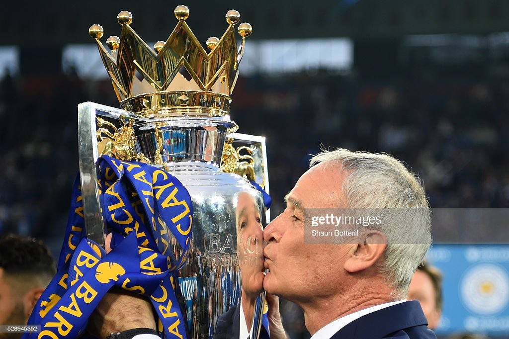 Claudio Ranieri Manager of Leicester City kisses the Premier League Trophy after the Barclays Premier League match between Leicester City and Everton at The King Power Stadium on May 7, 2016 in Leicester, United Kingdom.