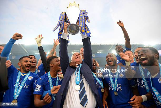 Claudio Ranieri Manager Of Leicester City Lifts The Premier League Trophy As Players Celebrate The Season