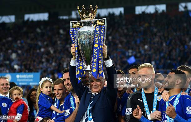 Claudio Ranieri Manager of Leicester City lifts the Premier League Trophy as players and staffs celebrate the season champions after the Barclays...