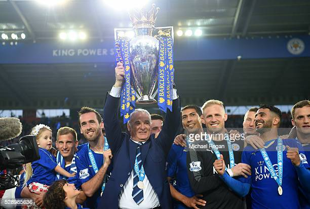 Claudio Ranieri Manager of Leicester City lifts the Premier League Trophy as players and staffs celebrate the season champion after the Barclays...