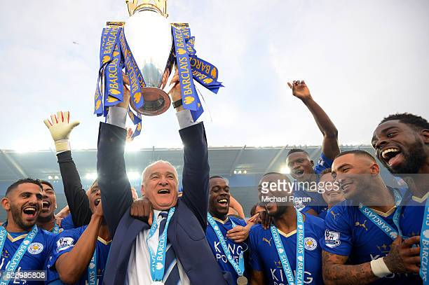 Claudio Ranieri Manager of Leicester City lifts the Premier League Trophy as players celebrate the season champions after the Barclays Premier League...
