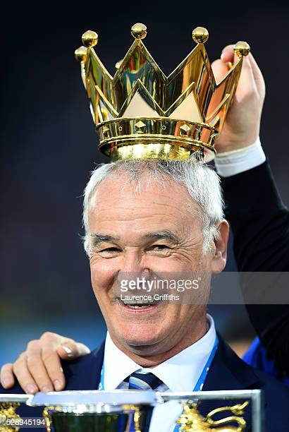 Claudio Ranieri Manager of Leicester City poses with the crown of the Premier League Trophy after the Barclays Premier League match between Leicester...