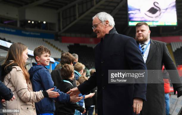 Claudio Ranieri manager of Leicester City shakes hands with fans as he arrives prior to the Premier League match between Swansea City and Leicester...