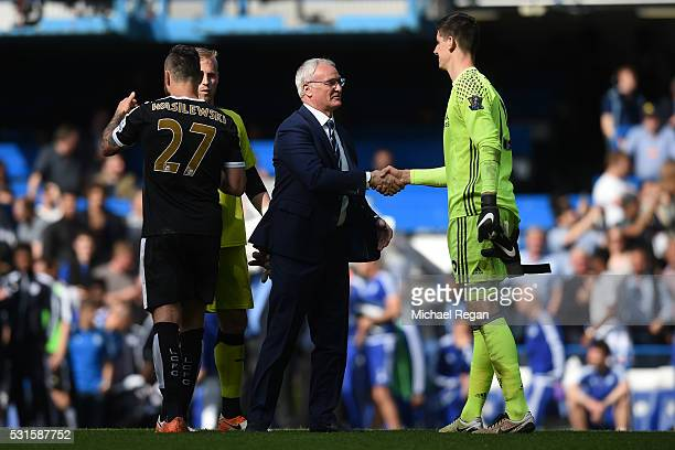 Claudio Ranieri Manager of Leicester City shakes hands with Thibaut Courtois of Chelsea after the Barclays Premier League match between Chelsea and...