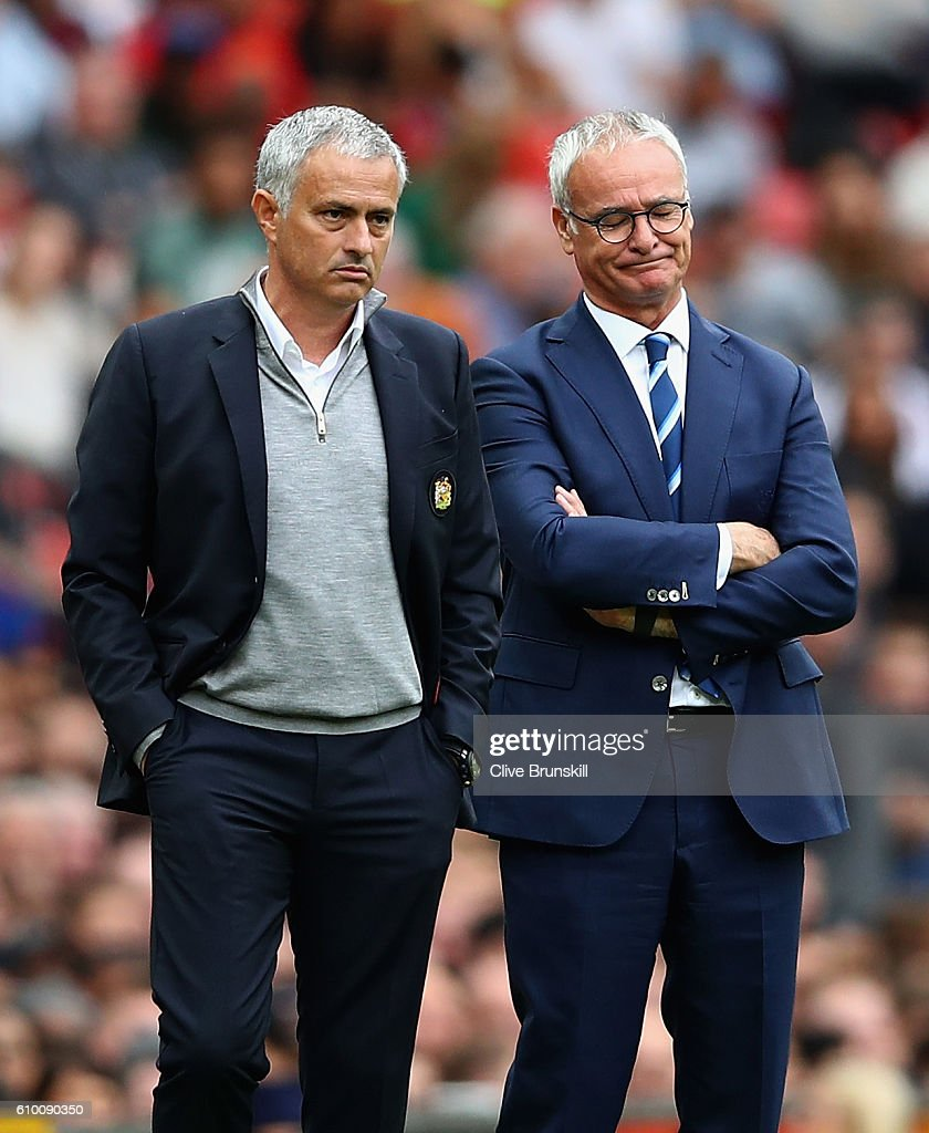 Claudio Ranieri, Manager of Leicester City shows his frustration as Jose Mourinho, Manager of Manchester United looks on during the Premier League match between Manchester United and Leicester City at Old Trafford on September 24, 2016 in Manchester, England.