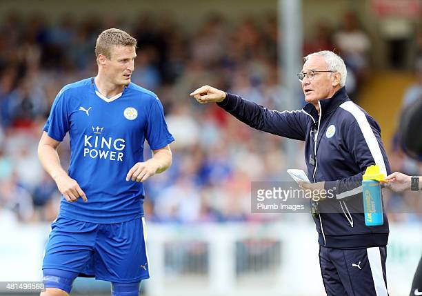 Claudio Ranieri of Leicester city gives instructions to Robert Huth of Leicester City during the preseason friendly between Lincoln City and...
