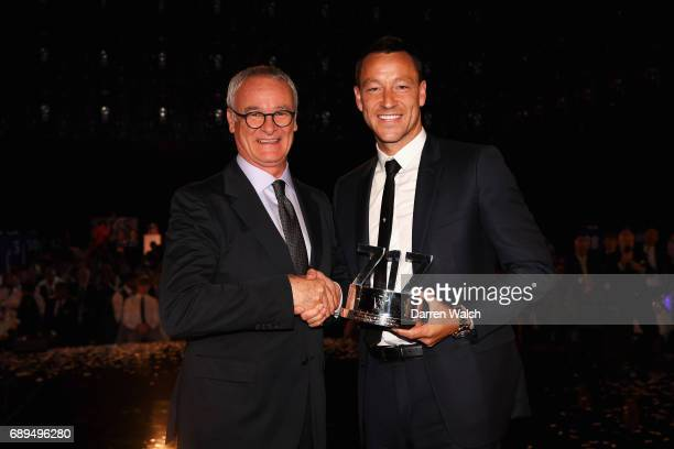 Claudio Ranieri presents John Terry of Chelsea poses with a Special Recognition award given to him by Chelsea during the Chelsea Player of the Year...