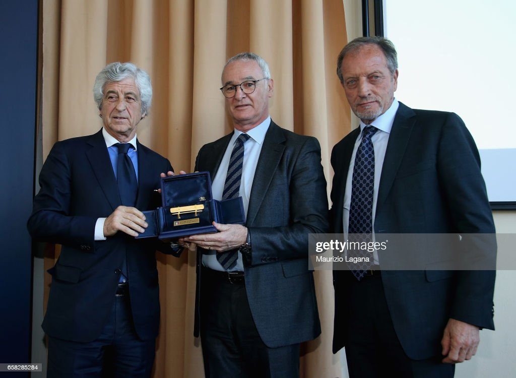 Claudio Ranieri receives the Panchina D'Oro Prize by Gianni Rivera (L) and Renzo Ulivieri (R) during Italian Football Federation 'Panchine D'Oro E D'Argento' Prize at Coverciano on March 27, 2017 in Florence, Italy.