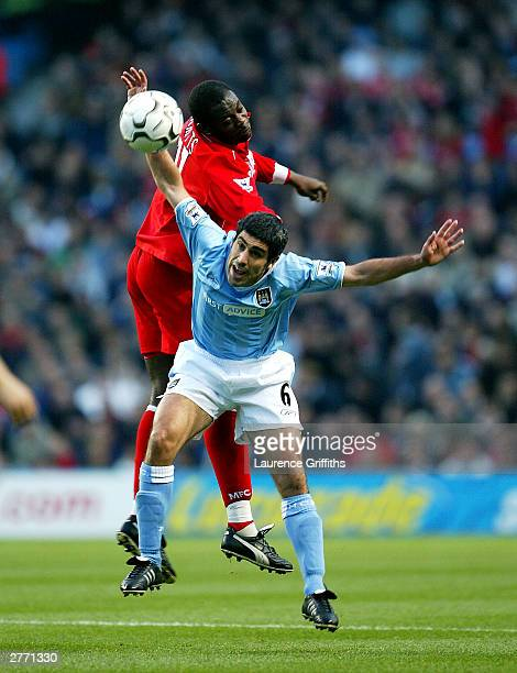 Claudio Reyna of Manchester City and Michael Ricketts of Middlesbrough both jump for the ball during the FA Barclaycard Premiership match between...
