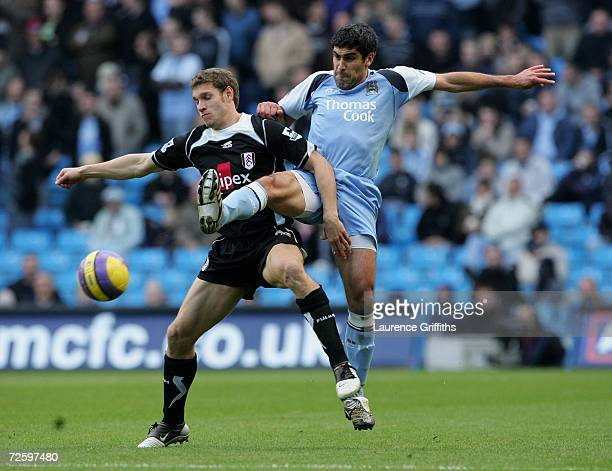 Claudio Reyna of Manchester City battles for the ball with Moritz Volz of Fulham during the Barclays Premiership match between Manchester City and...