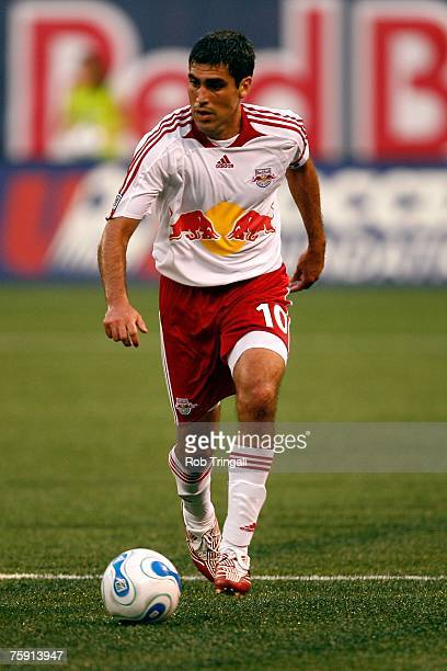 Claudio Reyna of the New York Red Bulls handles the ball against the New England Revolution on July 14 2007 at Giants Stadium in East Rutherford New...