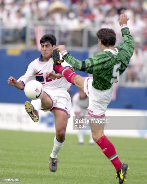 Claudio Reyna of the United States and Dulio Davino of Mexico in action during the match between Mexico and United States in Foxboro Massachusetts on...