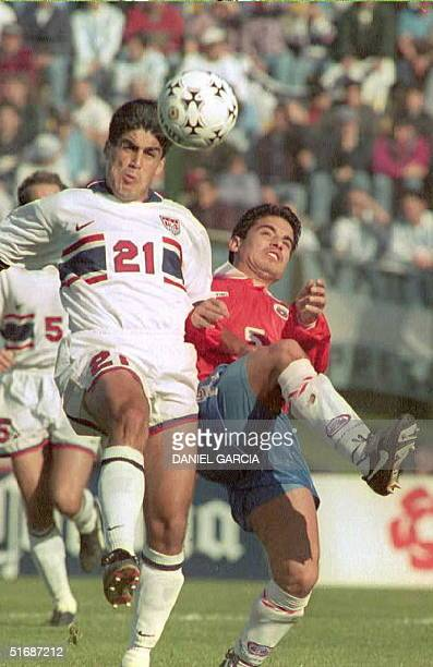 Claudio Reyna of the US heads the ball 08 July besides Chilean player Miguel Ramirez during their Copa America first-round match in Payandu, Uruguay....