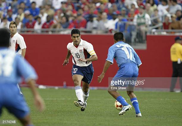 Claudio Reyna of the USA makes a short pass as William Torres Alegria of El Salvador defends on July 12 2003 at Gillette Stadium in Foxboro...