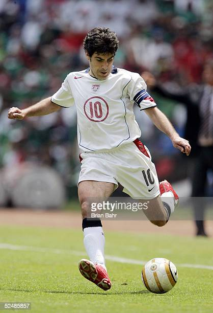 Claudio Reyna of the USA takes the ball down the field against Mexico in the second half during their 2006 FIFA World Cup qualifying match on March...