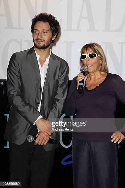 Claudio Santamaria receives the award for best supporting actor for the movie 'Baciami Ancora' from Alba Calia at the Kineo Diamanti Al Cinema Award...