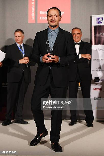Claudio Santamaria receives the Best Actor Award at the Kineo Diamanti Award Ceremony during the 73rd Venice Film Festival on September 4 2016 in...