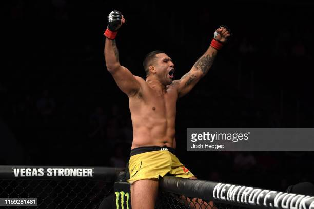 Claudio Silva of Brazil celebrates his submission victory over Cole Williams in their welterweight bout during the UFC Fight Night event at the...