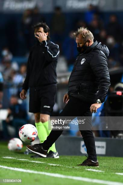 Claudio Sponton head coach of Platense kicks the ball during a match between Racing and Platense as part of Torneo Liga Profesional 2021 at...