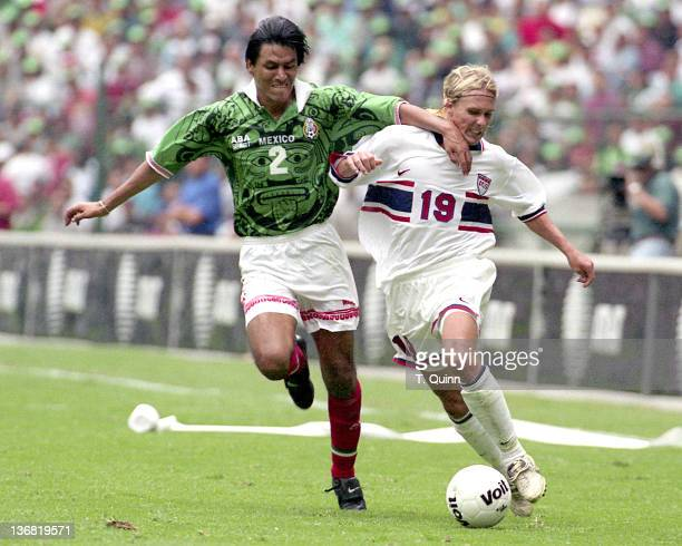 Claudio Suarez of Mexico and Chris Henderson of the United States in action during the game between United States and Mexico in Azteca stadium in...