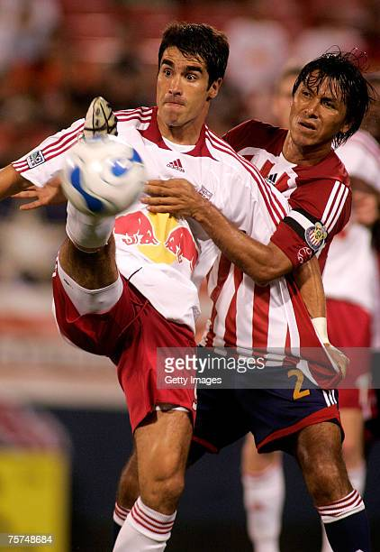 Claudio Suarez of the Club Deportivo Chivas USA and Juan Pablo Angel of the New York Red Bulls battle for control of the ball at Giants Stadium in...