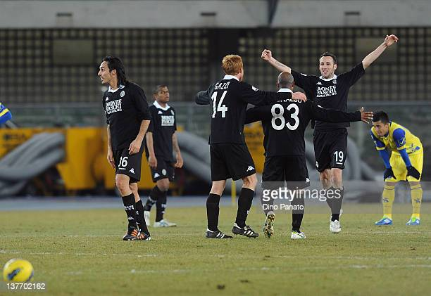 Claudio Terzi of Siena celebrates victory with his team-mates after the Tim Cup match between AC Chievo Verona and AC Siena at Stadio Marc'Antonio...