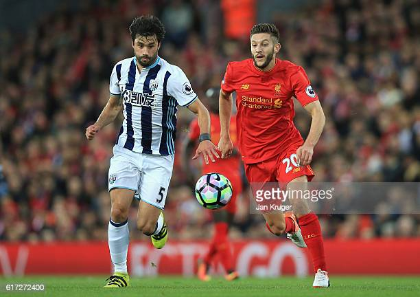 Claudio Yacob of West Bromwich Albion and Adam Lallana of Liverpool battle for possession during the Premier League match between Liverpool and West...