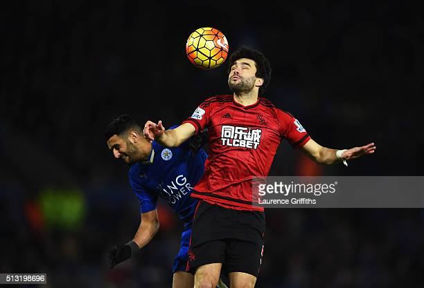 Claudio Yacob of West Bromwich Albion and Riyad Mahrez of Leicester City compete for the ball during the Barclays Premier League match between...