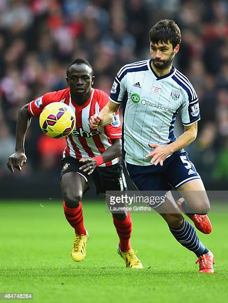 Claudio Yacob of West Bromwich Albion and Sadio Mane of Southampton chase the ball during the Barclays Premier League match between West Bromwich...