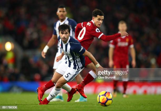 Claudio Yacob of West Bromwich Albion attempts to get away from Philippe Coutinho of Liverpool during the Premier League match between Liverpool and...